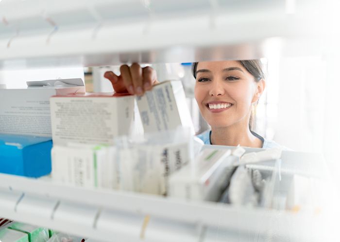 Pharmacist looking at drugs